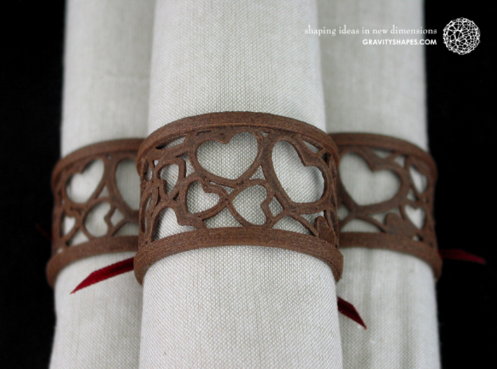 Set of 2 large napkin rings with Hearts 3d printed The photo shows an own print (FDM print) made of brown wood incl. decorative lacing.