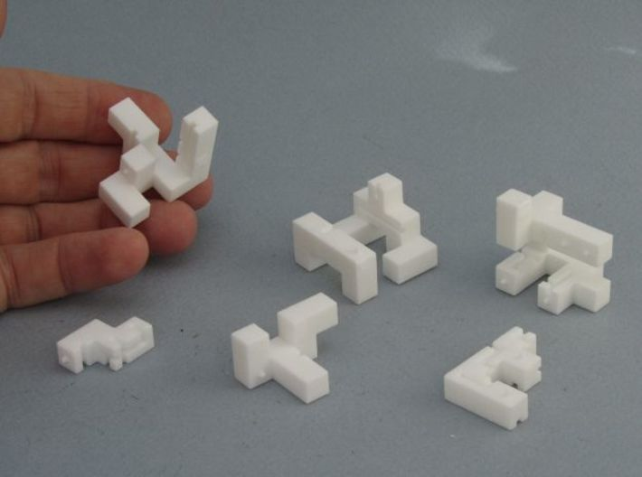 Titan – Interlocking Cube Puzzle w/ Pegs and Slots 3d printed Pegs and Slots form an internal maze