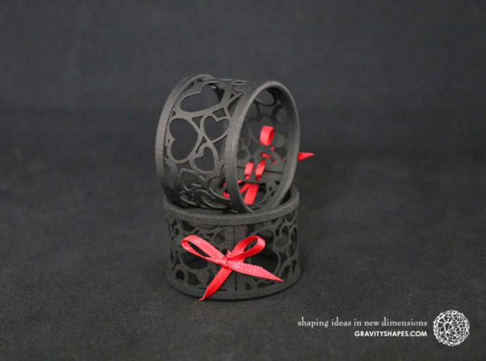 Set of 2 large napkin rings with Hearts 3d printed The photo shows prints made of black strong and flexible incl. red lacing.