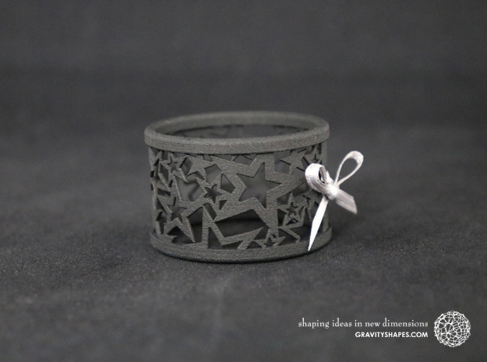 Set of 2 large Christmas napkin rings with Stars 3d printed The photo shows a print made of black strong and flexible incl. silver lacing.