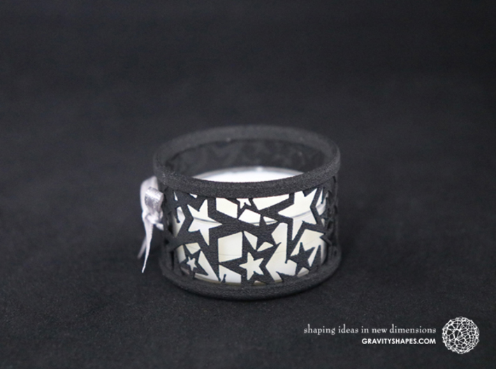 Small tealight holder with Stars  3d printed The photo shows a print made of black strong and flexible incl. silver lacing and a normal tealight candle.