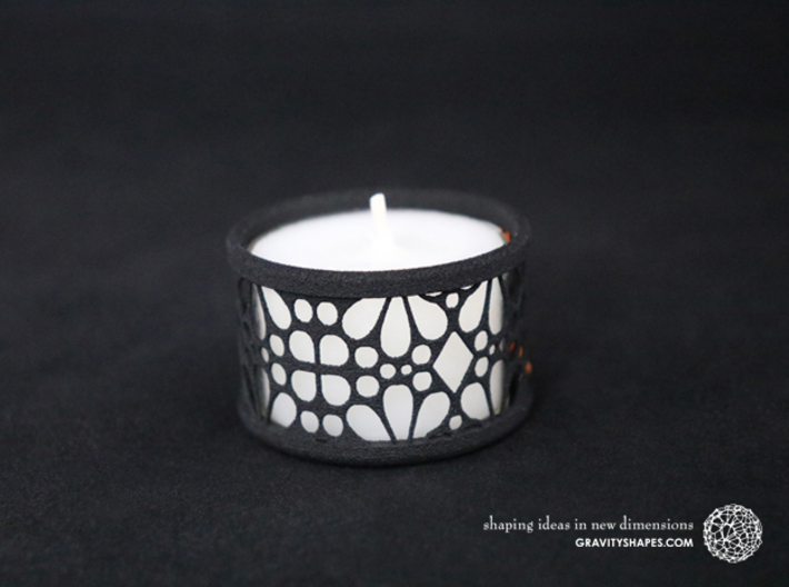Small tealight holder with Mosaic-3 3d printed The photo shows a print made of black strong and flexible incl. orange lacing and a high 8h tealight candle.