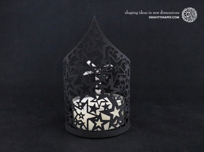 Christmas tealight holder with stars 3d printed The photo shows a print made of black strong and flexible incl. silver lacing.