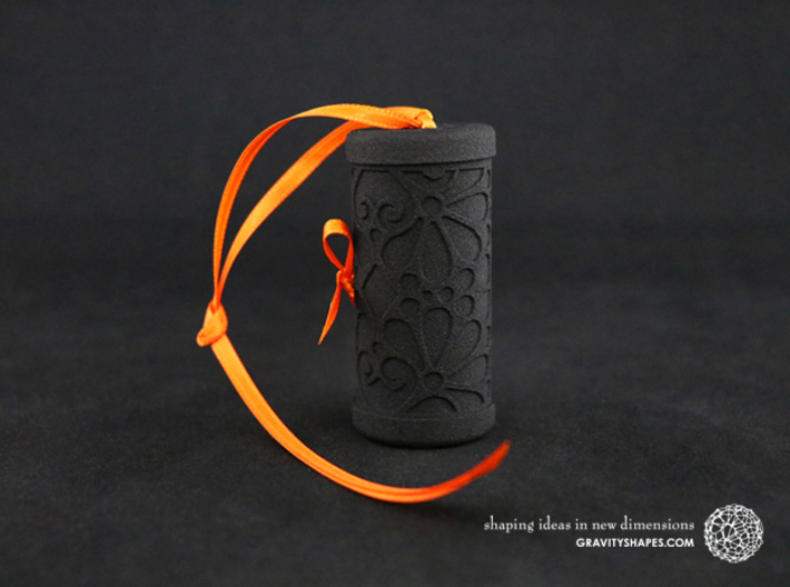 Solid Gift roll small with Mosaic-3 (6 cm) 3d printed The photo shows a print made of black strong and flexible incl. orange lacing.
