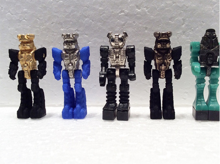 Diaclone Inchman Blue Star Body 3d printed Multiple metal print options, (Polished Bronze, Polished Nickel Steel and Polished Gold Steel) shown here with two classic diaclone drivers (center, far right) for comparison