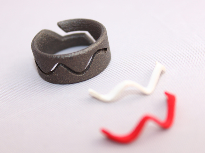 RING WAVE CUSTOMIZABLE Size 7 3d printed Ring wave with white or red plastic inserts.