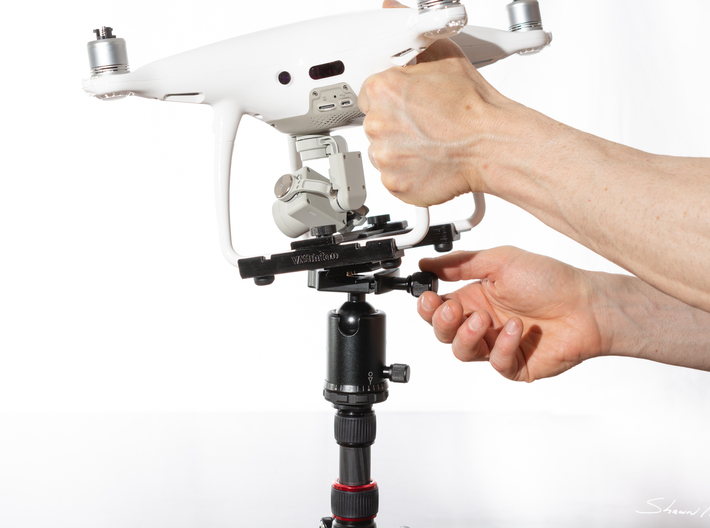 Tripod Mount Adapter for DJI Phantom 4 Drones 3d printed Easily removing the Phantom 4 from gear.