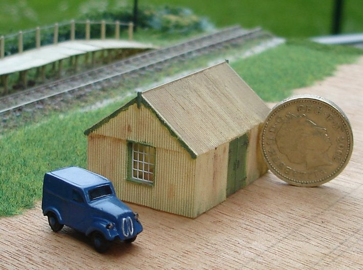 Corrugated Iron Shed 2mm/ft 1/152 (N scale) 3d printed Painted model, with Ratio etched brass window frames fitted. Bachmann vehicle and one pound coin included to indicate size.