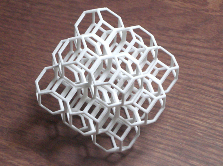Truncated Octahedra 3d printed 14 packed cubeoctahedra filling space. Photo is of white strong & flexible plastic.