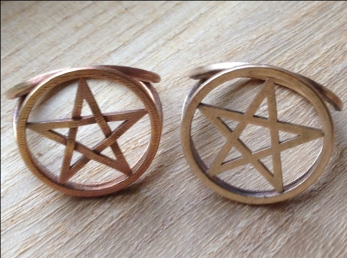 Pentacle ring (customize) 3d printed Comparing the styles of pentacles. On the left is the braided pentacle in raw bronze, on the right is the standard pentacle in raw brass.