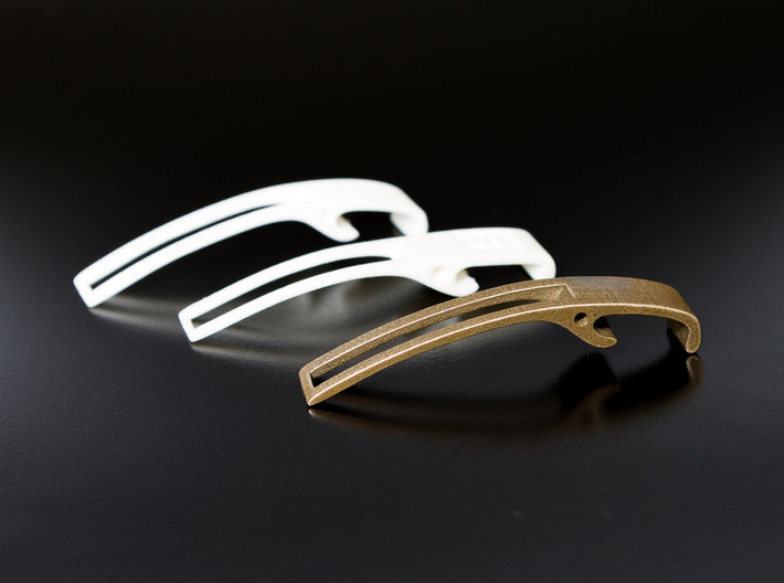 Bottle Opener 3d printed Stainless Steel Bottle Opener along side plastic prototypes