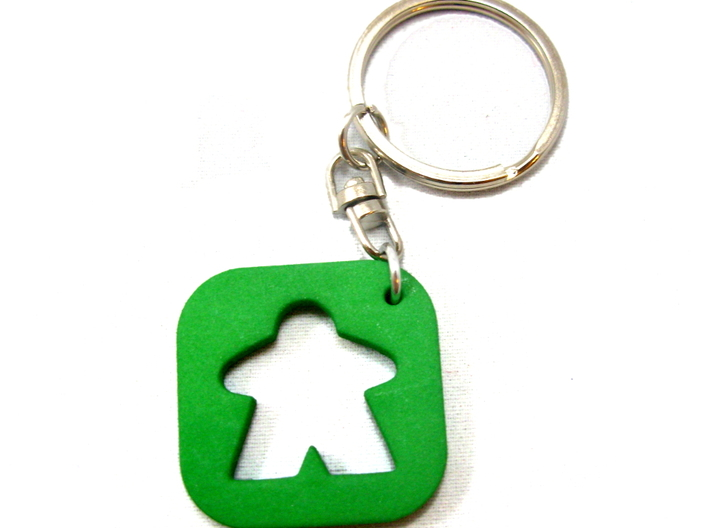Meeple Keychain Silhouette, Board Game Keyring 3d printed Photo of keychain printed in green strong and flexible. Key ring and jump ring are not included.