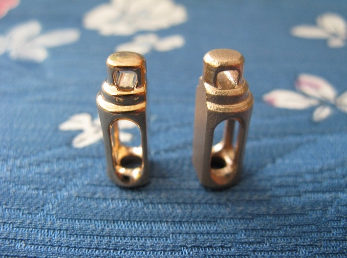 Tritium Earrings 2  (3x11mm Vials) 3d printed This photo shows both the polished and raw bronze finishes, as a comparison. It is only possible to order the earrings in one finish.