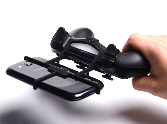 PS4 controller & Xolo Q600 3d printed In hand - A Samsung Galaxy S3 and a black PS4 controller