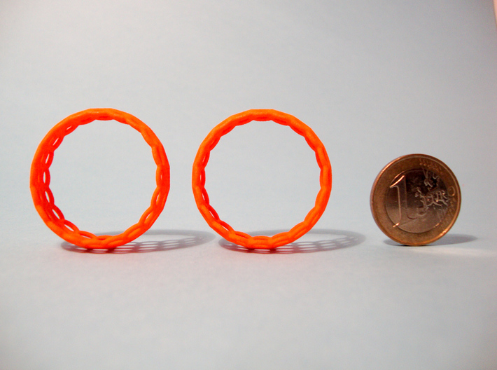 Wired Beauty 5 Hoop Earrings 30mm 3d printed Earrings and 1€ coin for scale.