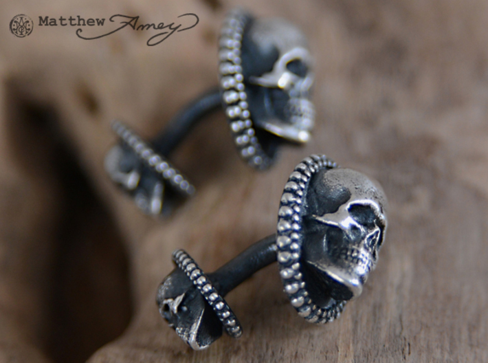 Skull cuff link - 25mm 3d printed Raw silver that I applied a patina to. I then hand-polished off the patina.