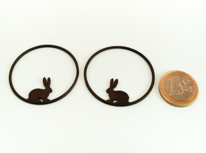 Bunny Hoop Earrings 40mm 3d printed Bunny Hoops in Matte Black Steel with 1€ coin for scale.