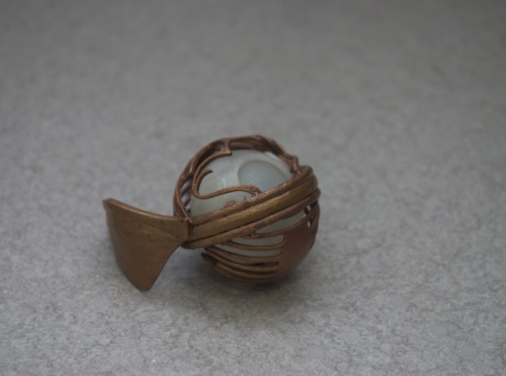Golden Snitch (top) 3d printed Used gold paint from a crafts store