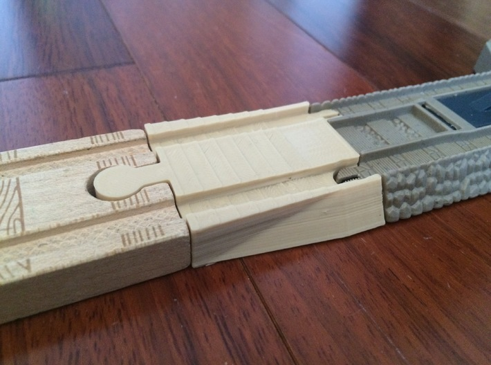 Male Wooden Railway to Trackmaster Adapter 3d printed Test print done on consumer 3d printer. Part ordered from Shapeways will be exactly the same size but professionally printed at higher quality.