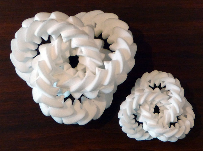 Triple gear (small) 3d printed Size comparison between the large and small versions of the Triple Gear.