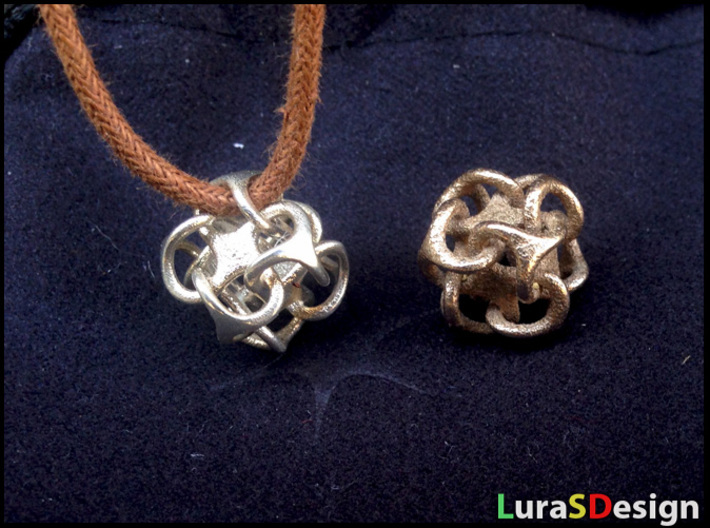 Mini Metatron 3d printed Polished Silver with 3mm cord next to Stainless Steel