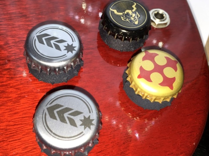 Bottlecap Tone Knob - 6MM 3d printed A set of 4 bottlecap knobs in black on a cherry SG background.