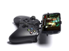 Xbox One controller & Lava Pixel V1 - Front Rider 3d printed Side View - A Samsung Galaxy S3 and a black Xbox One controller