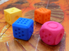 Variable pip die - roll your own dice 3d printed Yellow, blue orange and pink dice