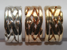 WOW5 Puzzle Ring 3d printed Interlocking Silver, Bronze, and Brass in the solved state.