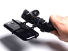PS3 controller & BQ Aquaris M4.5 3d printed In hand - A Samsung Galaxy S3 and a black PS3 controller