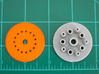 LED Mounting Disc - 1:350 Alternative Part 3d printed Printed part (left - orange) compared with original kit part (right).