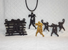 Zombie On A Fence Pendant  3d printed Group of Zombie Pendants, unpainted plastic, polished gold steel & matte black steel.