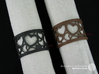 Set of 6 large napkin rings with Hearts 3d printed The photo shows an own print (FDM print) made of brown/black wood incl. decorative lacing.