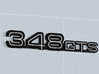 348GTS BADGE 3d printed 348 GTS badge in Matte Black Steel with white plastic inserts -sold apart-, render.