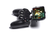 PS4 controller & Lenovo A316i 3d printed Side View - A Samsung Galaxy S3 and a black PS4 controller